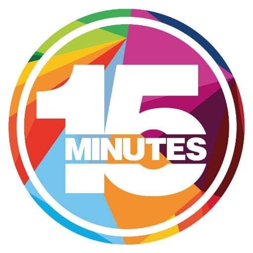 Värikäs piirros, ikään kuin kellotaulu, jossa lukee 15 minuuttia.